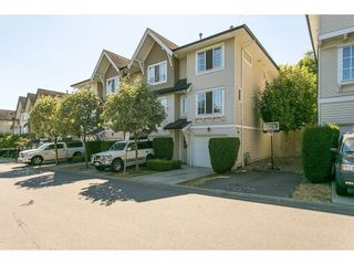 """Photo 1: 97 20540 66 Avenue in Langley: Willoughby Heights Townhouse for sale in """"Amberleigh"""" : MLS®# R2098835"""