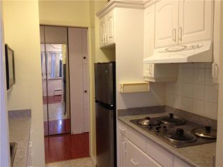 """Photo 2: # 305 6026 TISDALL ST in Vancouver: Oakridge VW Condo for sale in """"OAKRIDGE TOWERS"""" (Vancouver West)  : MLS®# V1035898"""
