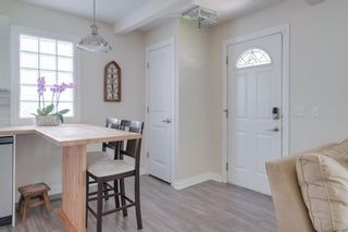 Photo 3: 42 Quentin Place SW in Calgary: Garrison Woods Semi Detached for sale : MLS®# A1122774