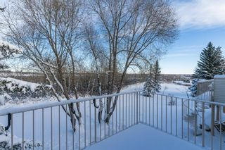 Photo 3: 113 Shawnee Rise SW in Calgary: Shawnee Slopes Semi Detached for sale : MLS®# A1068673