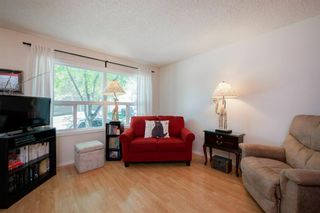 Photo 11: 332 Queenston Heights SE in Calgary: Queensland Row/Townhouse for sale : MLS®# A1114442