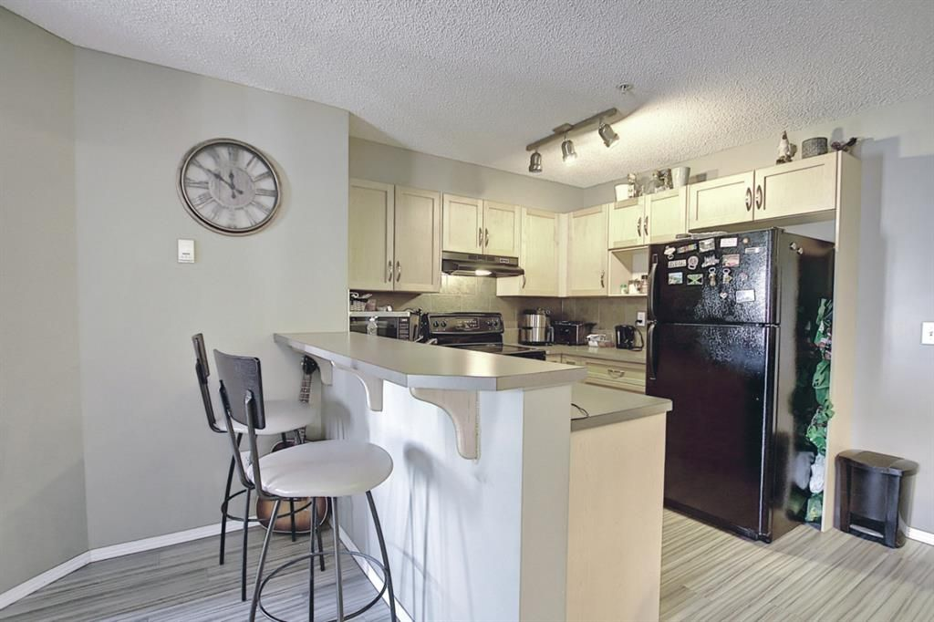 Photo 5: Photos: 2211 43 Country Village Lane NE in Calgary: Country Hills Village Apartment for sale : MLS®# A1085719