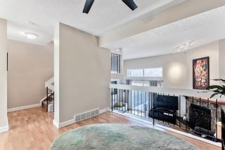 Photo 14: 108 Glamis Terrace SW in Calgary: Glamorgan Row/Townhouse for sale : MLS®# A1070053