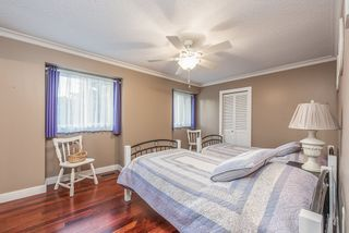 """Photo 12: 4948 198B Street in Langley: Langley City House for sale in """"Park Estates"""" : MLS®# R2555386"""