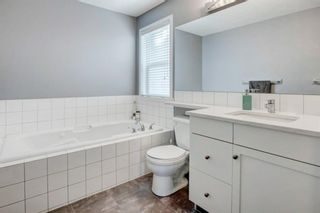Photo 19: 192 Cougartown Close SW in Calgary: Cougar Ridge Detached for sale : MLS®# A1106763