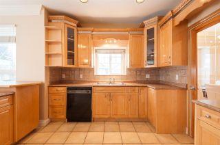Photo 10: 5867 138 Street in Surrey: Panorama Ridge House for sale : MLS®# R2540887