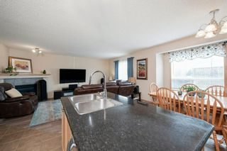 Photo 9: 55 Cougar Ridge Court SW in Calgary: Cougar Ridge Detached for sale : MLS®# A1110903