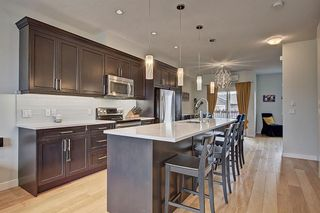 Photo 12: 42 248 Kinniburgh Boulevard: Chestermere Row/Townhouse for sale : MLS®# A1093515