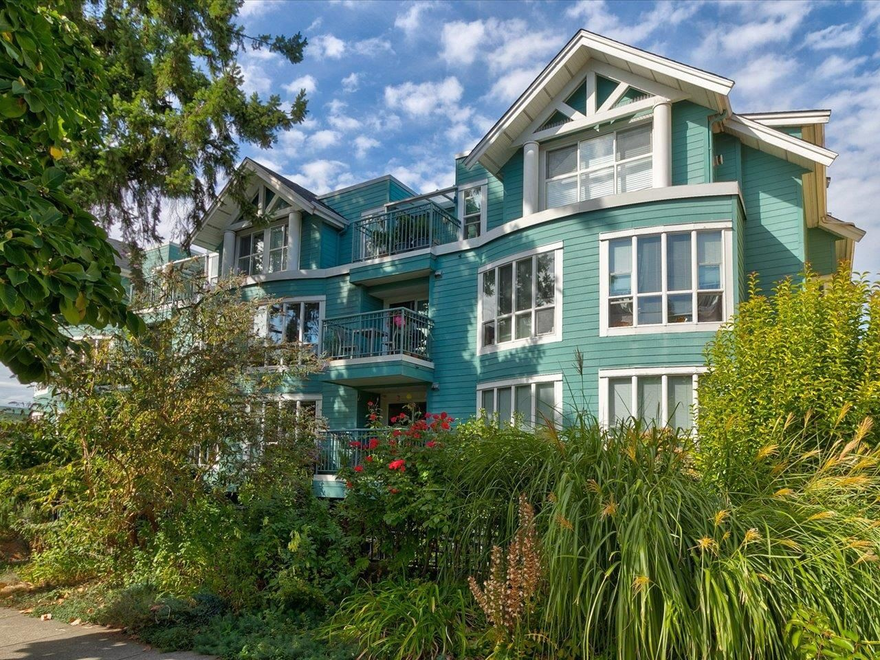 """Main Photo: 202 1617 GRANT Street in Vancouver: Grandview Woodland Condo for sale in """"Evergreen Place"""" (Vancouver East)  : MLS®# R2621057"""