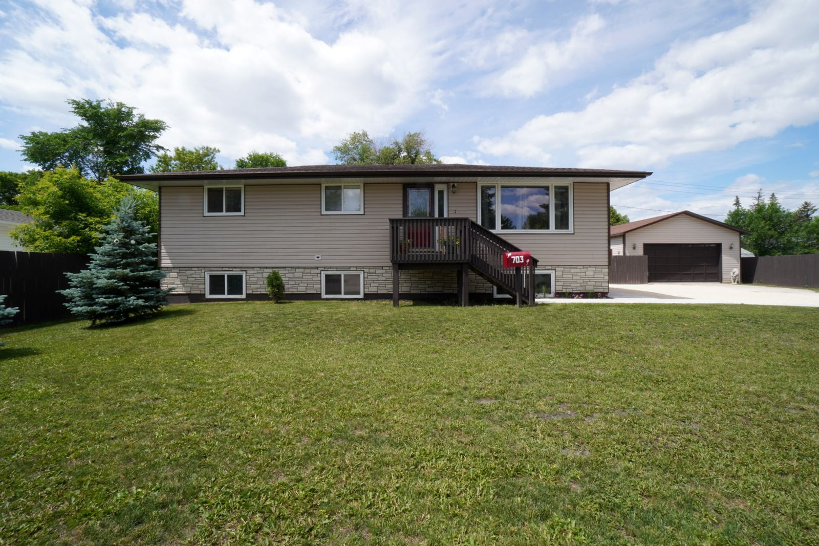 Main Photo: 703 4th Street NE in Portage la Prairie: House for sale : MLS®# 202115922