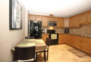 Photo 7: 3009 Windsong Boulevard SW: Airdrie Row/Townhouse for sale : MLS®# A1099332