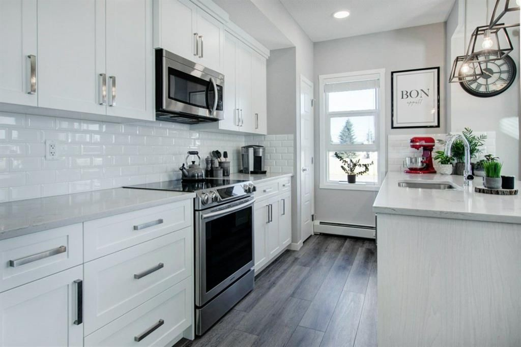 Main Photo: 211 370 Harvest Hills Common NE in Calgary: Harvest Hills Apartment for sale : MLS®# A1060358