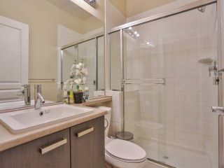 Photo 12: 409 9399 TOMICKI Avenue in Richmond: West Cambie Condo for sale : MLS®# V1053278