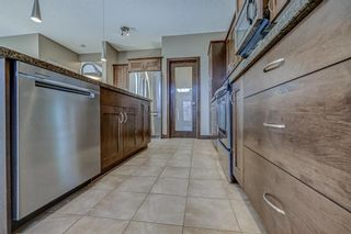 Photo 9: 26 BRIGHTONWOODS Bay SE in Calgary: New Brighton Detached for sale : MLS®# A1110362