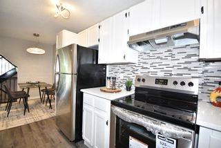 Photo 13: 5 903 67 Avenue SW in Calgary: Kingsland Row/Townhouse for sale : MLS®# A1115343