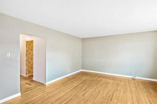 Photo 7: 7103 5 Street SW in Calgary: Kingsland Detached for sale : MLS®# A1093853