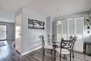 Photo 4: 104 7172 Coach Hill Road SW in Calgary: Coach Hill Row/Townhouse for sale : MLS®# A1097069