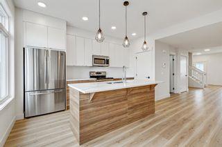 Photo 8: 101 Heartland Street: Cochrane Semi Detached for sale : MLS®# A1095665