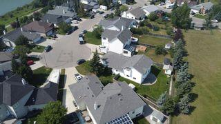 Photo 49: 426 Riverview Green: Cochrane Detached for sale : MLS®# A1132015