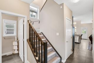 Photo 4: 121 Everhollow Rise SW in Calgary: Evergreen Detached for sale : MLS®# A1146816