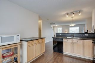 Photo 6: 55 Toscana Garden NW in Calgary: Tuscany Row/Townhouse for sale : MLS®# C4243908