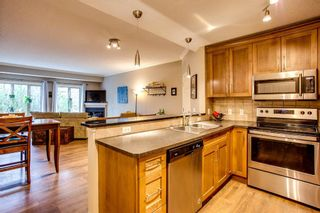 Photo 5: 222 15 Sunset Square: Cochrane Row/Townhouse for sale : MLS®# A1060876