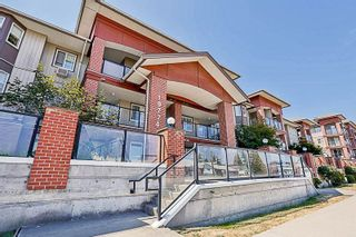 Photo 1: 302 19774 56 AVENUE in Langley: Langley City Condo for sale : MLS®# R2231875