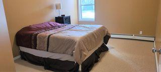 Photo 18: 106 248 Sunterra Ridge Place: Cochrane Apartment for sale : MLS®# A1097518