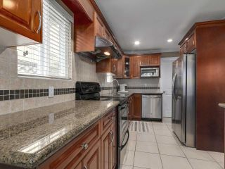 """Photo 8: 8445 FREMLIN Street in Vancouver: Marpole 1/2 Duplex for sale in """"MARPOLE"""" (Vancouver West)  : MLS®# R2135044"""