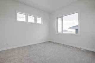 Photo 19: 108 Creekside Drive SW in Calgary: C-168 Semi Detached for sale : MLS®# A1062823