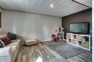 Photo 23: 31 Stradwick Place SW in Calgary: Strathcona Park Semi Detached for sale : MLS®# A1119381
