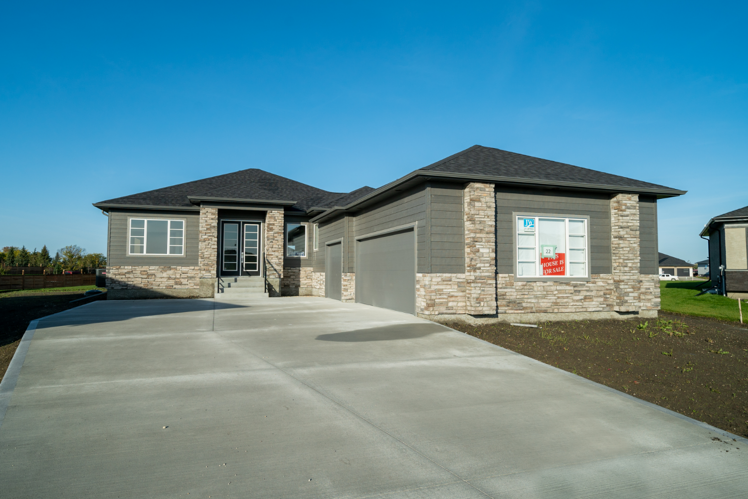 Main Photo: 22 JANAKAS Place | Headingley North Winnipeg