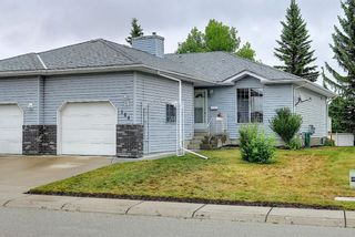 Photo 1: 184 Woodside Close NW: Airdrie Semi Detached for sale : MLS®# A1137637