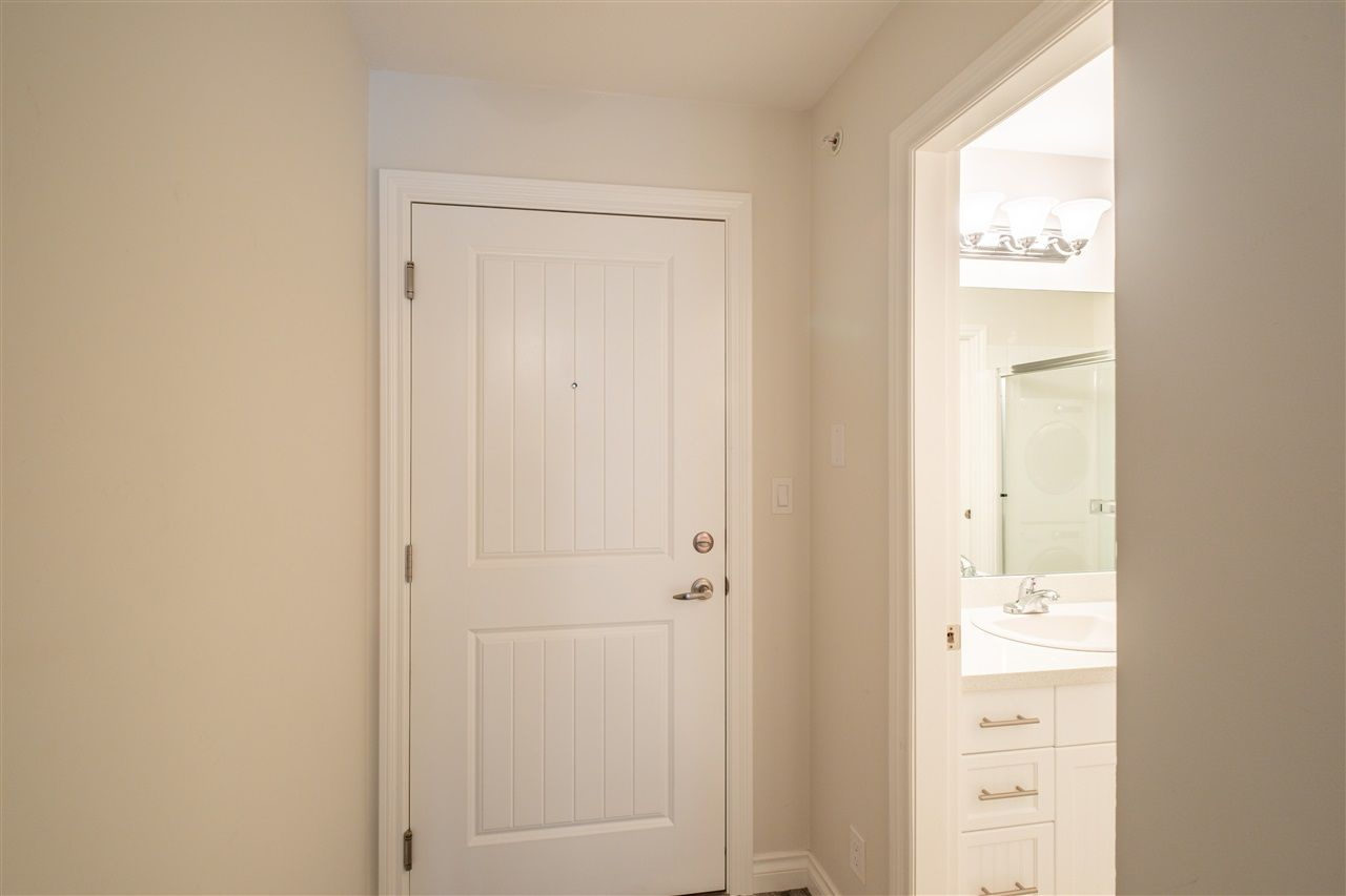 """Photo 4: Photos: 409 5650 201A Street in Langley: Langley City Condo for sale in """"Paddington Station"""" : MLS®# R2566139"""