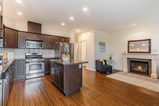 """Photo 10: 6880 208 Street in Langley: Willoughby Heights Condo for sale in """"Milner Heights"""" : MLS®# R2583647"""