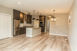 Photo 8: 166 Howse Common in Calgary: Livingston Detached for sale : MLS®# A1143791