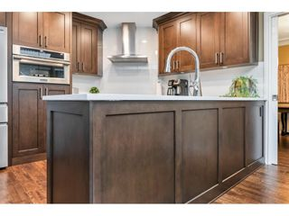 """Photo 10: 118 6109 W BOUNDARY Drive in Surrey: Panorama Ridge Townhouse for sale in """"LAKEWOOD GARDENS"""" : MLS®# R2625696"""