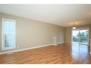 Photo 4: 74 WEST TERRACE Road: Cochrane House for sale : MLS®# C4073559