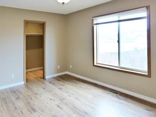 Photo 11: 107 Mt Allan Circle SE in Calgary: McKenzie Lake Detached for sale : MLS®# A1068557