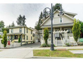 "Photo 2: 102 218 BEGIN Street in Coquitlam: Maillardville Townhouse for sale in ""Begin Square"" : MLS®# R2504206"