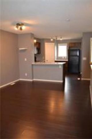 Photo 6: 92 Panamount Drive NW in Calgary: Panorama Hills Row/Townhouse for sale : MLS®# A1122234