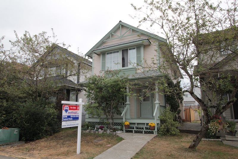 """Main Photo: 18486 65 Avenue in Surrey: Cloverdale BC House for sale in """"Clover Valley Station"""" (Cloverdale)  : MLS®# R2201415"""