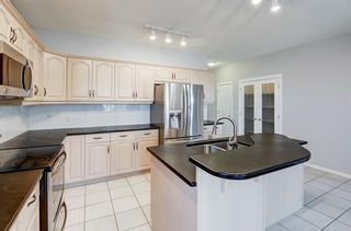 Photo 7: 79 Tuscany Village Court NW in Calgary: Tuscany Semi Detached for sale : MLS®# A1101126