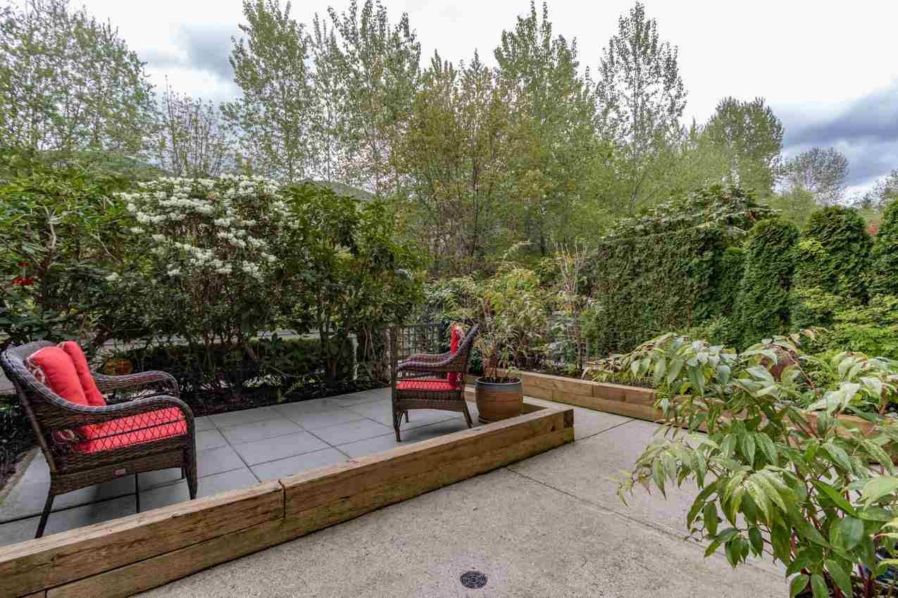 """Main Photo: 206 3600 WINDCREST Drive in North Vancouver: Roche Point Condo for sale in """"WNDSONG AT RAVEN WOODS"""" : MLS®# R2573504"""