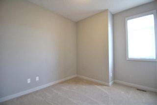 Photo 21: 296 Silverado Plains Park SW in Calgary: Silverado Row/Townhouse for sale : MLS®# A1065666