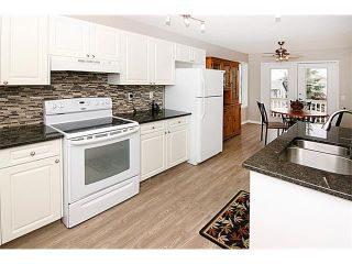 Photo 9: 81 COVEWOOD Close NE in Calgary: Coventry Hills House for sale : MLS®# C4014534
