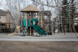 Photo 3: 27 Cougarstone Circle SW in Calgary: Cougar Ridge Detached for sale : MLS®# A1088974