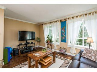 "Photo 5: 228 13880 70 Avenue in Surrey: East Newton Condo for sale in ""Chelsea Gardens"" : MLS®# R2563447"