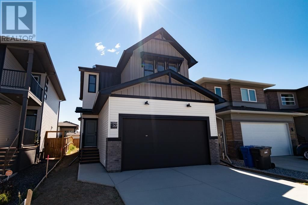 Main Photo: 1263 Pacific Circle W in Lethbridge: House for sale : MLS®# A1118679