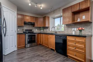 Photo 5: 122 Luxstone Road SW: Airdrie Detached for sale : MLS®# A1129612